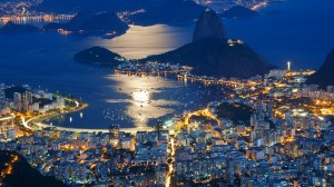 Night view of Sugar Loaf mountain and Botafogo in Rio de Janeiro.